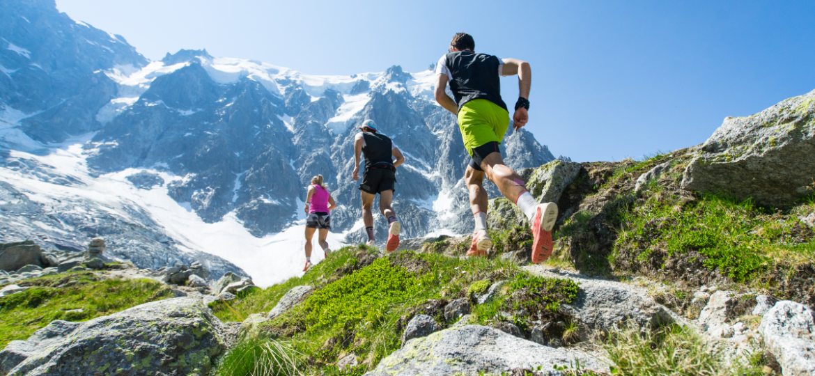 Guys running in mountains small
